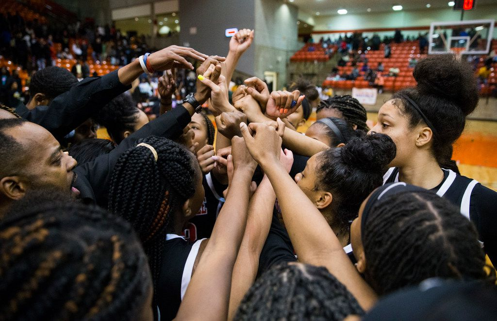 Duncanville celebrates a 47-43 win after a Class 6A Region I quarterfinal girls basketball game between Duncanville and DeSoto on Tuesday, February 25, 2020 at Wilkerson-Greines Activity Center in Fort Worth. (Ashley Landis/The Dallas Morning News)
