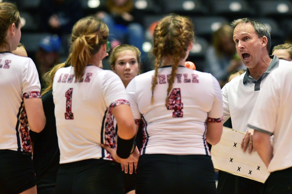 Argyle head coach Clark Oberle with his players during a timeout against Robinson, in a class 4A UIL State Volleyball Tournament semifinal game, Thursday, November 19, 2015, at the Curtis Culwell Center in Garland, TX. David Minton/DRC
