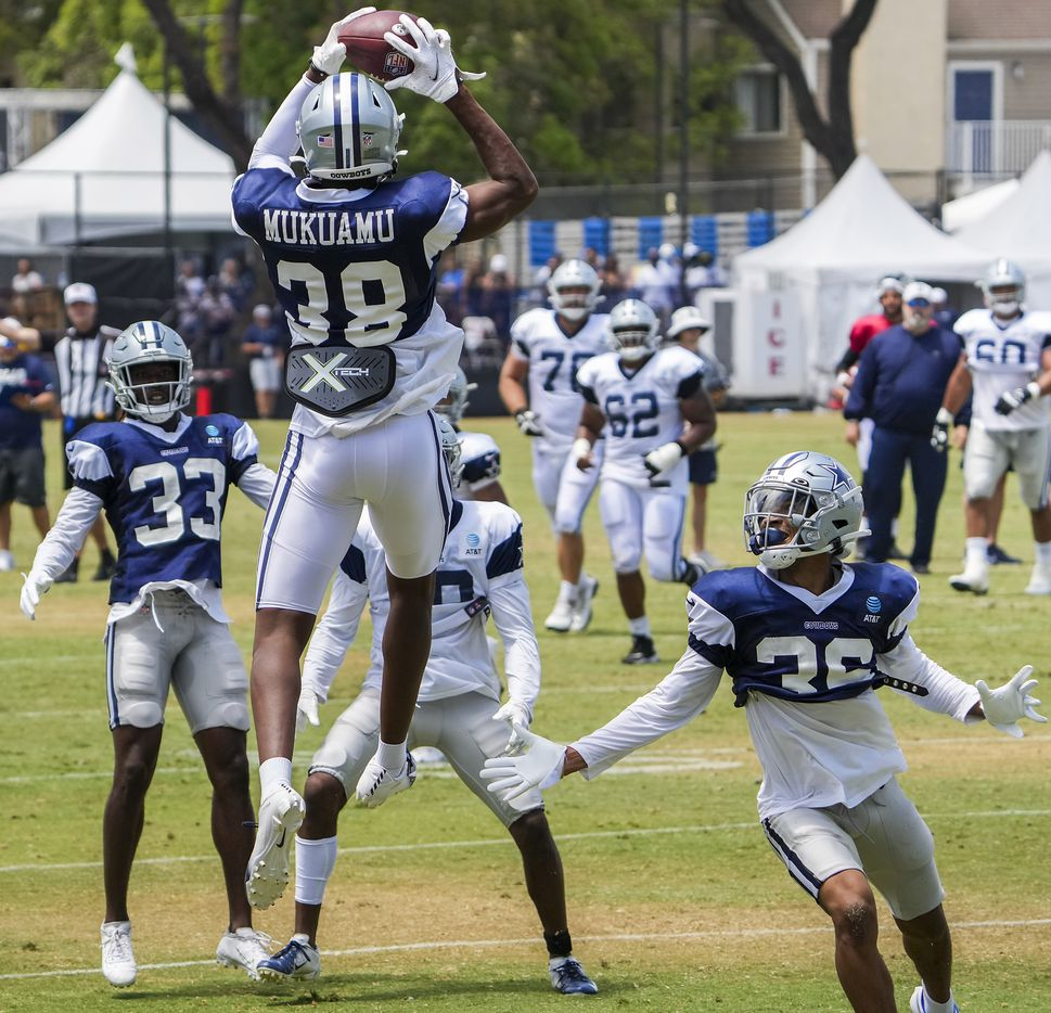 Dallas Cowboys cornerback Israel Mukuamu (38) intercepts a pass in a team drill during a practice at training camp on Wednesday, July 28, 2021, in Oxnard, Calif.