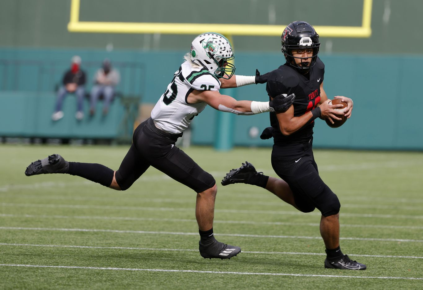 Southlake Carroll defender Barrett Baker (25) chases Euless Trinity receiver Carey Lawson (18) during the Class 6A Division I Region I high school football final, in Arlington, Texas, on Jan. 2, 2020. (Michael Ainsworth/Special Contributor)