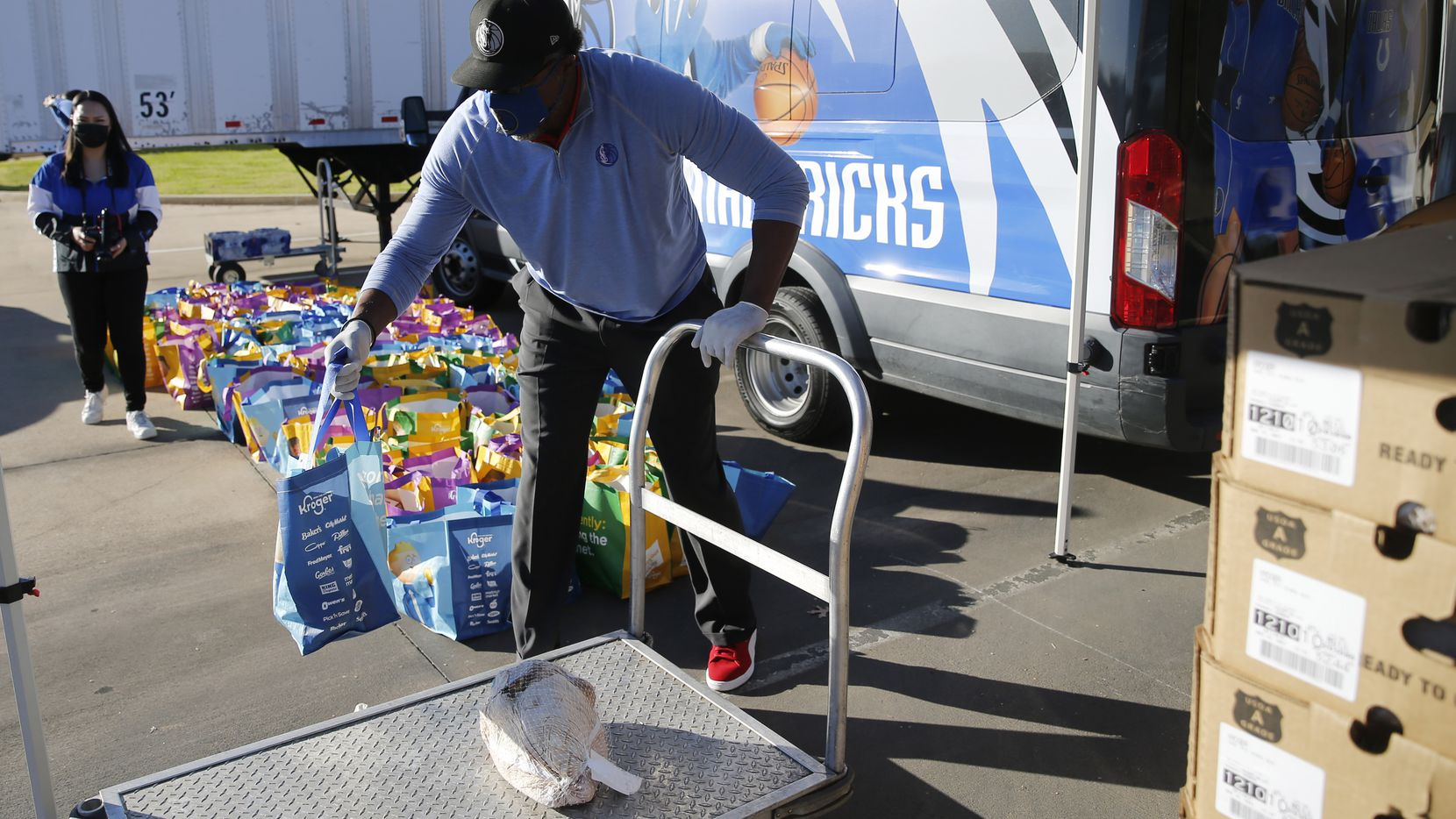 Former Dallas Mavericks player Cedric Ceballos prepares to give out food during a drive-through food distribution at Buckner Humanitarian Aid Center on Tuesday, November 17, 2020 in Dallas. The Dallas Mavericks in partnership with Kroger provided 200 families with turkey, stuffing and more for the Thanksgiving holiday.