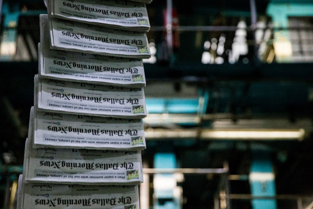 Copies of The Dallas Morning News as printing presses roll at the newspaper's North Plant in Plano, Texas.