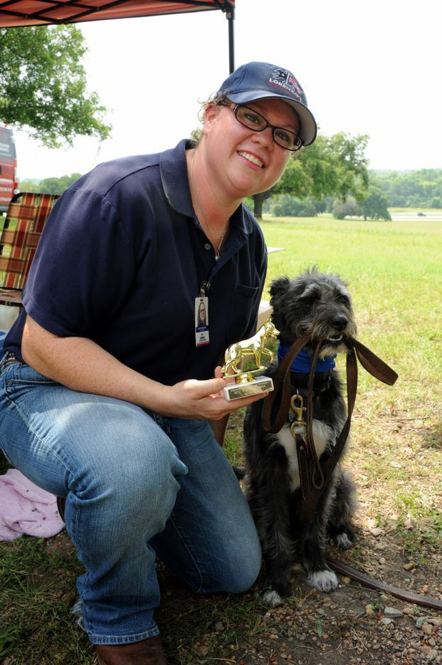 Two-year-old Ziggy and his mom Ashley Engelhart celebrate his first place best stupid dog trick award at the 21st annual Dog Day Afternoon at Flagpole Hill in Dallas, TX on June 6, 2015.