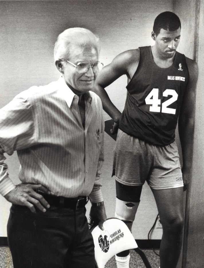 Dallas Mavericks owner Don Carter (left) and player Roy Tarpley after a morning practice where Tarpley confirmed that he has an alcohol and cocaine problem, and also told his teammates. Tarpley first notified the club of his problem last June. He is undergoing a counseling program.
