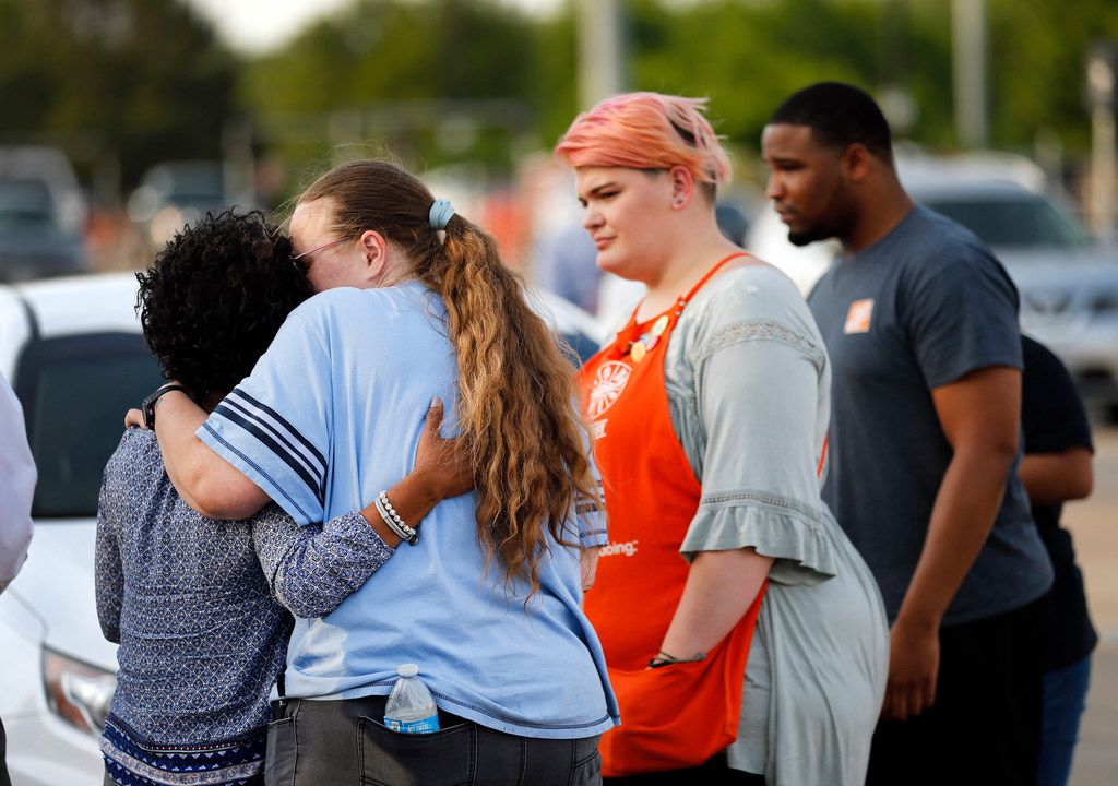 Home Depot employees were comforted by friends Tuesday outside the store on Forest Central Drive where two officers and the store's loss-prevention officer were shot.