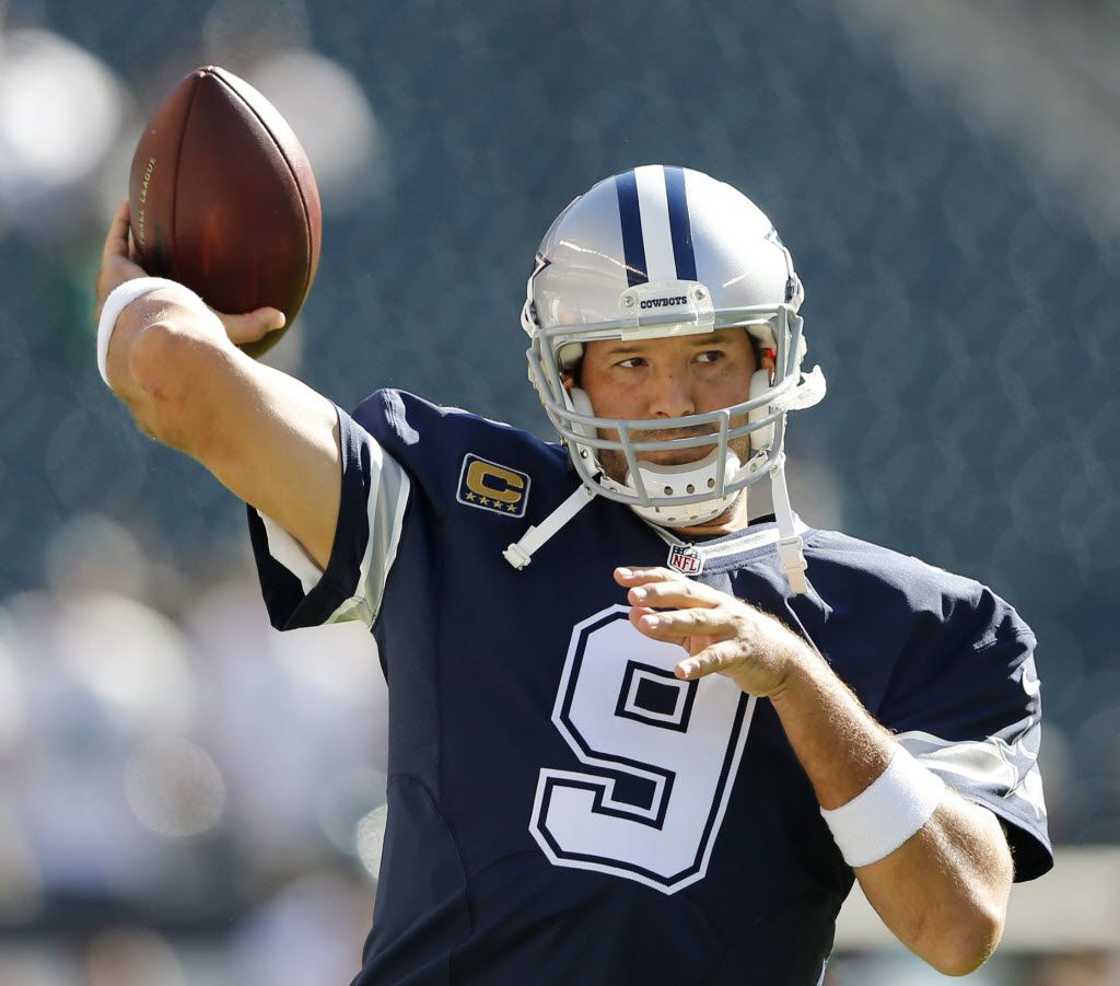 Dallas Cowboys quarterback Tony Romo (9) throws the ball during warm ups before a game against the Philadelphia Eagles at Lincoln Financial Field in Philadelphia, on Sunday, September 20, 2015. (Vernon Bryant/The Dallas Morning News)
