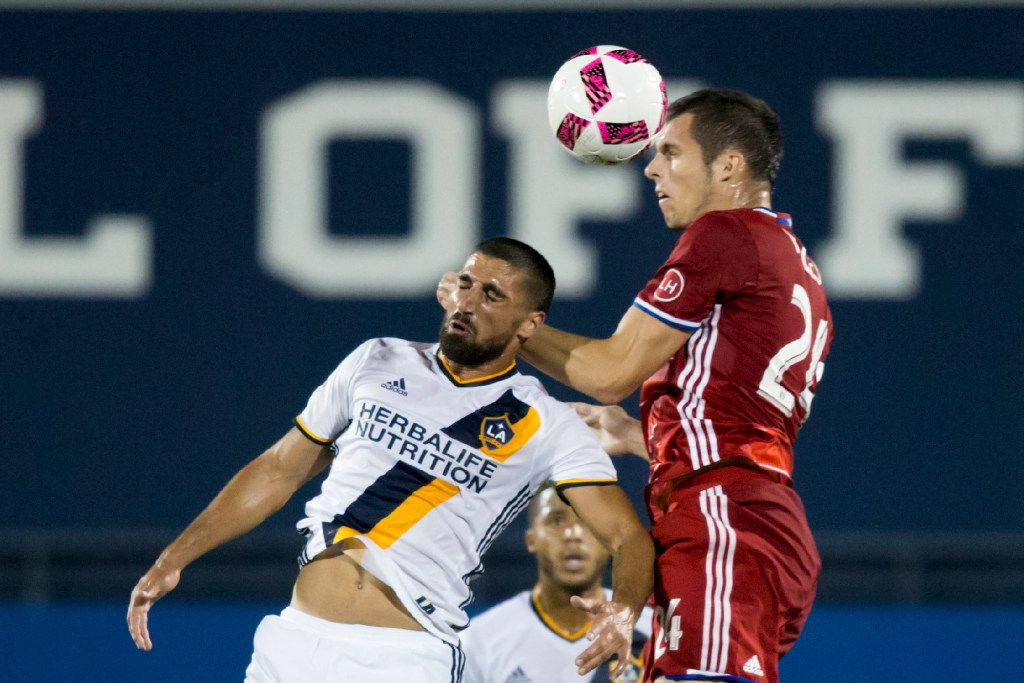 FC Dallas defender Matt Hedges (24) heads the ball over LA Galaxy midfielder Sebastian Lletget (17) during a MLS soccer match between the LA Galaxy and FC Dallas at Toyota Stadium on Oct. 1, 2016 in Frisco, Texas. (Ting Shen/The Dallas Morning News)
