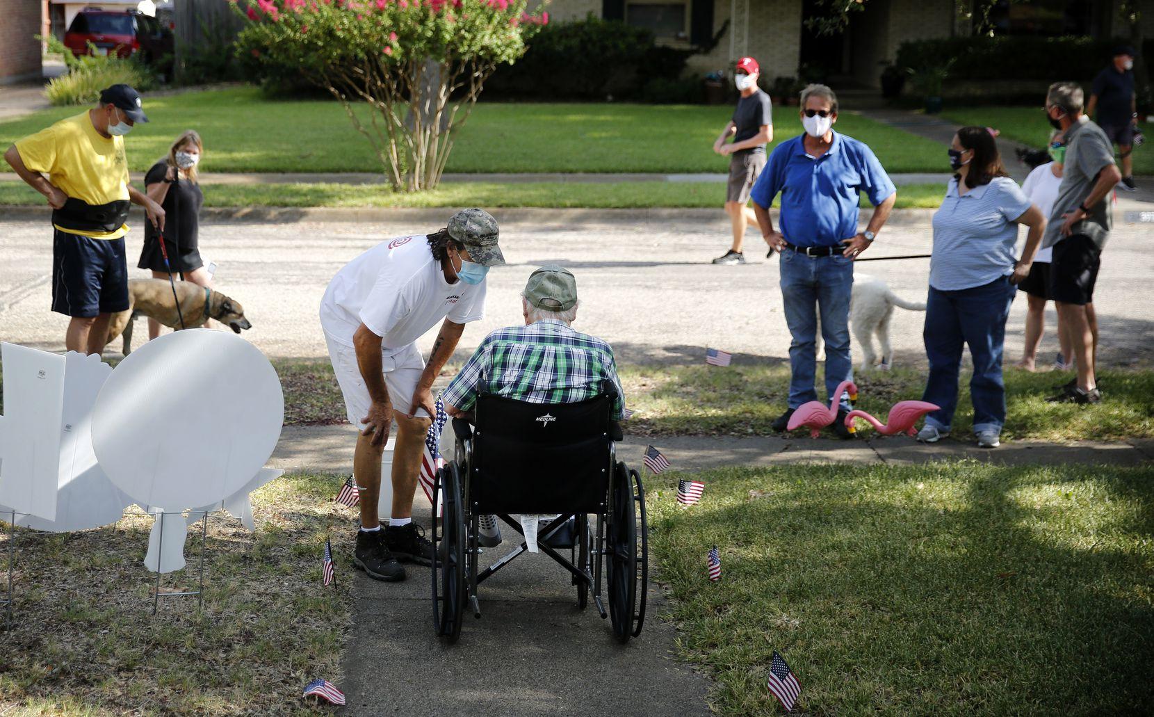 Next-door neighbor Mark Batchelor (center-left) was among Dieter's many congratulants.