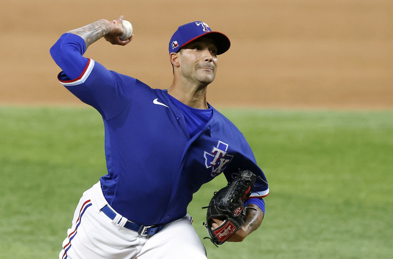 Texas Rangers relief pitcher Matt Bush throws against the Milwaukee Brewers in the eighth inning at Globe Life Field in Arlington, Texas. The teams were playing in an exhibition game, Monday, March 29, 2021.