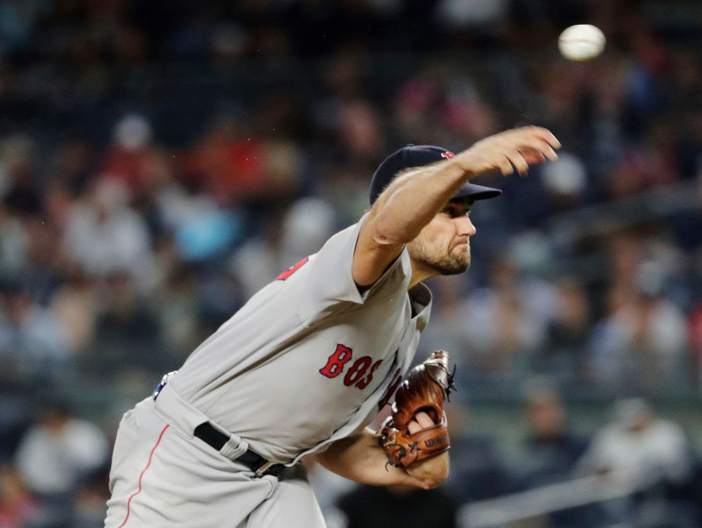 Boston Red Sox's Nathan Eovaldi delivers a pitch during the first inning of the team's baseball game against the New York Yankees on Tuesday, Sept. 18, 2018, in New York. (AP Photo/Frank Franklin II)