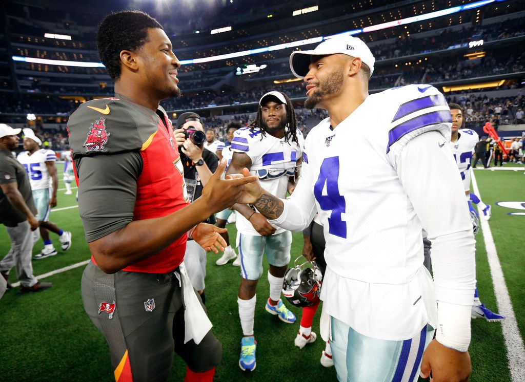 Dallas Cowboys quarterback Dak Prescott (4) and Tampa Bay Buccaneers quarterback Jameis Winston (3) greet one another on the field following their preseason game at AT&T Stadium in Arlington, Texas, Thursday, August 29, 2019. Neither quarterback played. (Tom Fox/The Dallas Morning News)