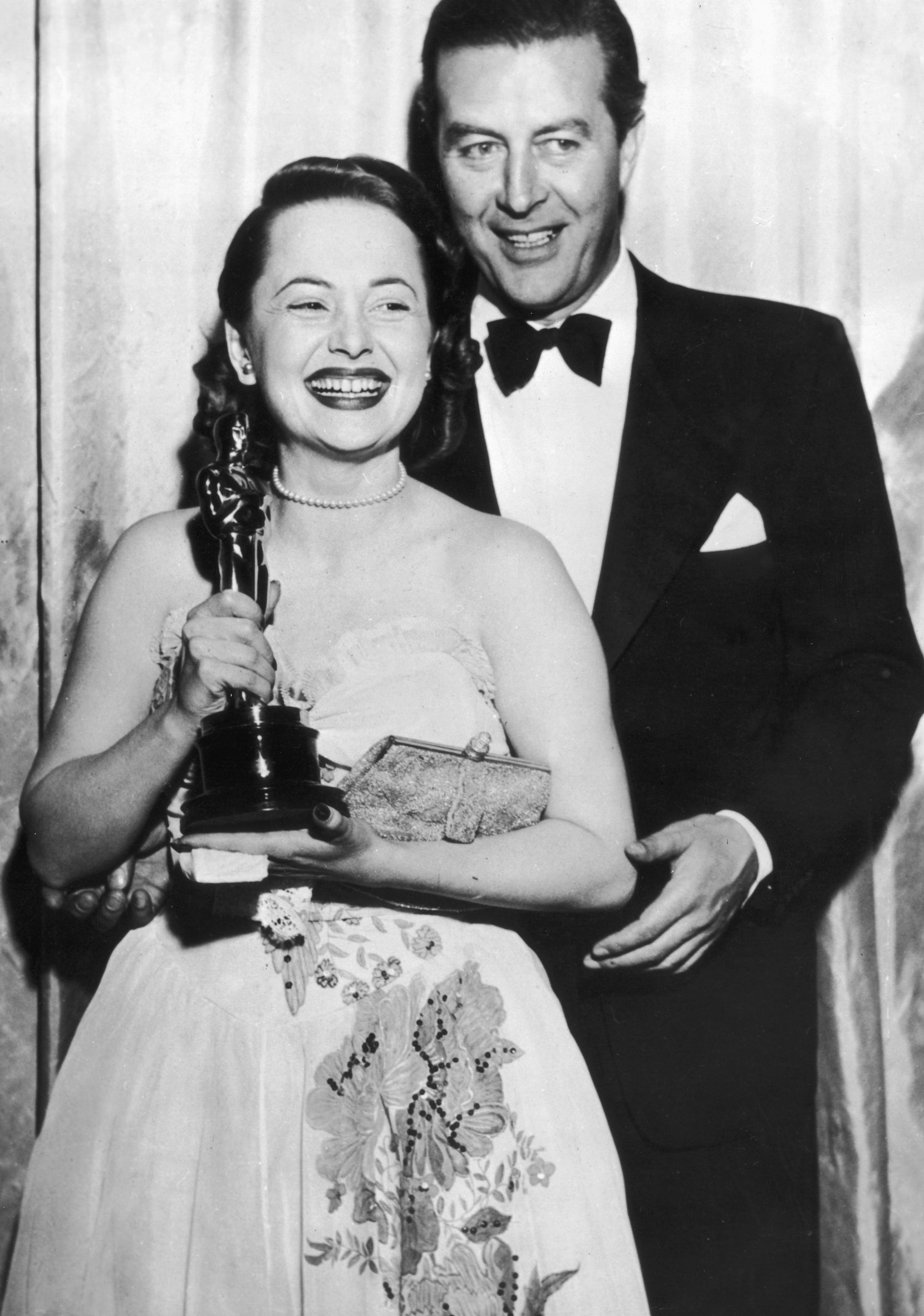 Actress Olivia de Havilland receivers her Oscar from actor Ray Milland for her performance in 'To Each his Own'
