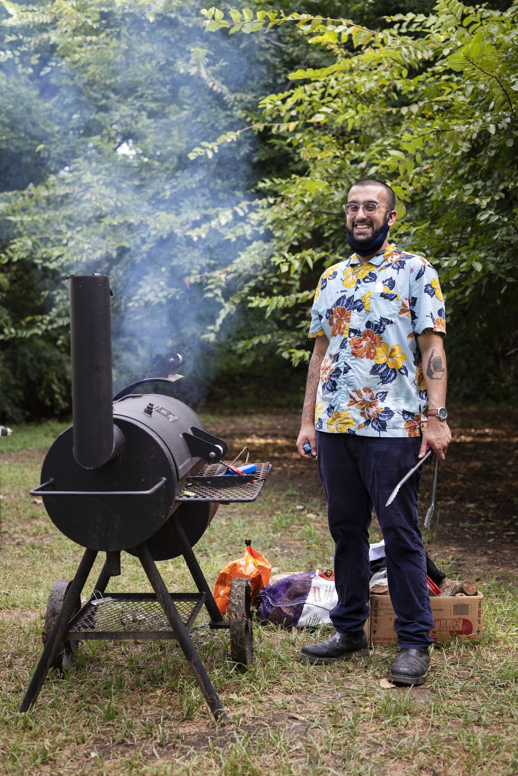 Chef Usama Khalid during a PunjabiTex BBQ popup at Sweet Pass Sculpture Park in Dallas, on Saturday, Aug. 14, 2021.