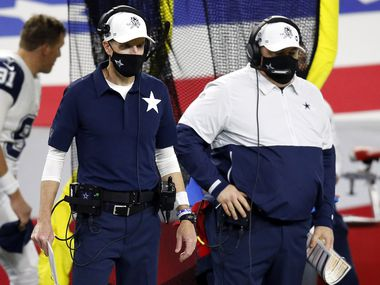 Dallas Cowboys special teams coordinator John Fassel (left) and head football coach Mike McCarthy watch their team play after they didn't convert a fourth down on a fake punt in the fourth quarter at AT&T Stadium in Arlington, Thursday, November 26, 2020. The Cowboys lost, 41-16.