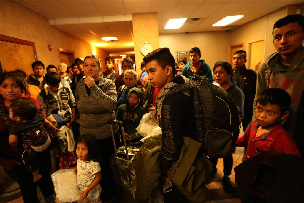 Central American migrants listen to an orientation speech by Annunciation House volunteer Dunya Cope (not pictured) after arriving at an El Paso motel where they will be housed and fed for a couple of days before going to be with family members elsewhere in the United States, on October 23, 2018.