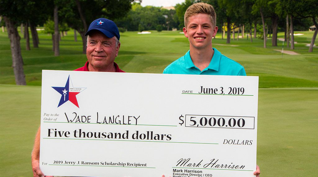 Jerry J. Ransom (left) presents a check for $5,000 to Wade Langley of Winnsboro, Texas, after Langley's name was chosen in a random drawing after the Jerry J. Ransom Pro-Junior-Am at Royal Oaks Country Club on Monday, June 3, 2019. Langley will be a senior in high school in the fall.