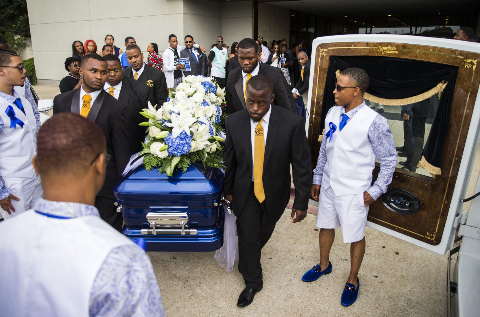 Pallbearers carry the casket of Muhlaysia Booker to a hearse Tuesday after a memorial service attended by hundreds of mourners.