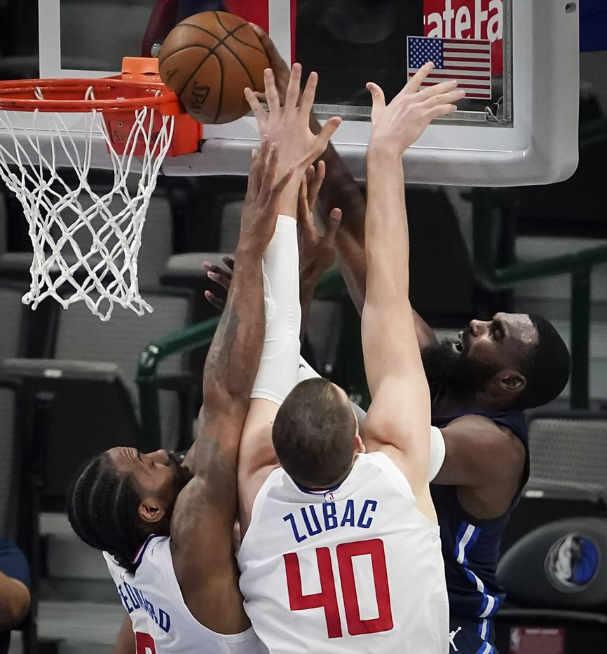 Dallas Mavericks forward Tim Hardaway Jr. (11) misses a dunk as LA Clippers forward Kawhi Leonard (2) and center Ivica Zubac (40) defend during the third quarter of an NBA playoff basketball game at American Airlines Center on Friday, May 28, 2021, in Dallas.