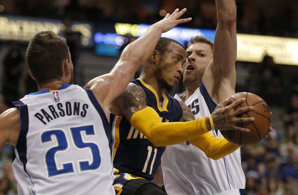 The Indiana Pacers' Monta Ellis (11) battles the Dallas Mavericks' David Lee, right, and Chandler Parsons (25) for space during the first half on Saturday, March 12, 2016, at American Airlines Center in Dallas. The Pacers won, 112-105. (Brandon Wade/Fort Worth Star-Telegram/TNS)