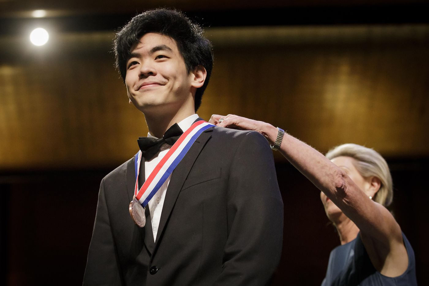 Daniel Hsu of the USA is presented with the bronze medal by Cliburn Chairman of the Board Carla Kemp Thompson during the Van Cliburn International Piano Competition awards ceremony at the Bass Performance Hall in Fort Worth on Saturday, June 10, 2017. (Smiley N. Pool/The Dallas Morning News)