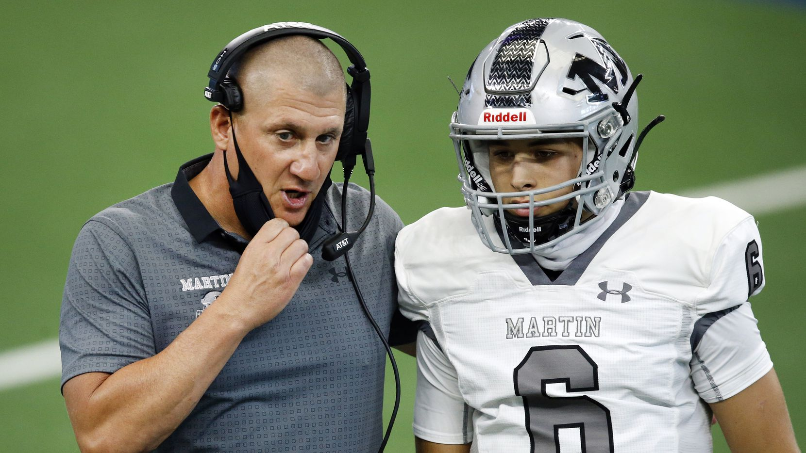 Arlington Martin head coach Bob Wager visits with his quarterback Zach Mundell (6) during a timeout against Denton Ryan at AT&T Stadium in Arlington, Friday, September 25, 2020.