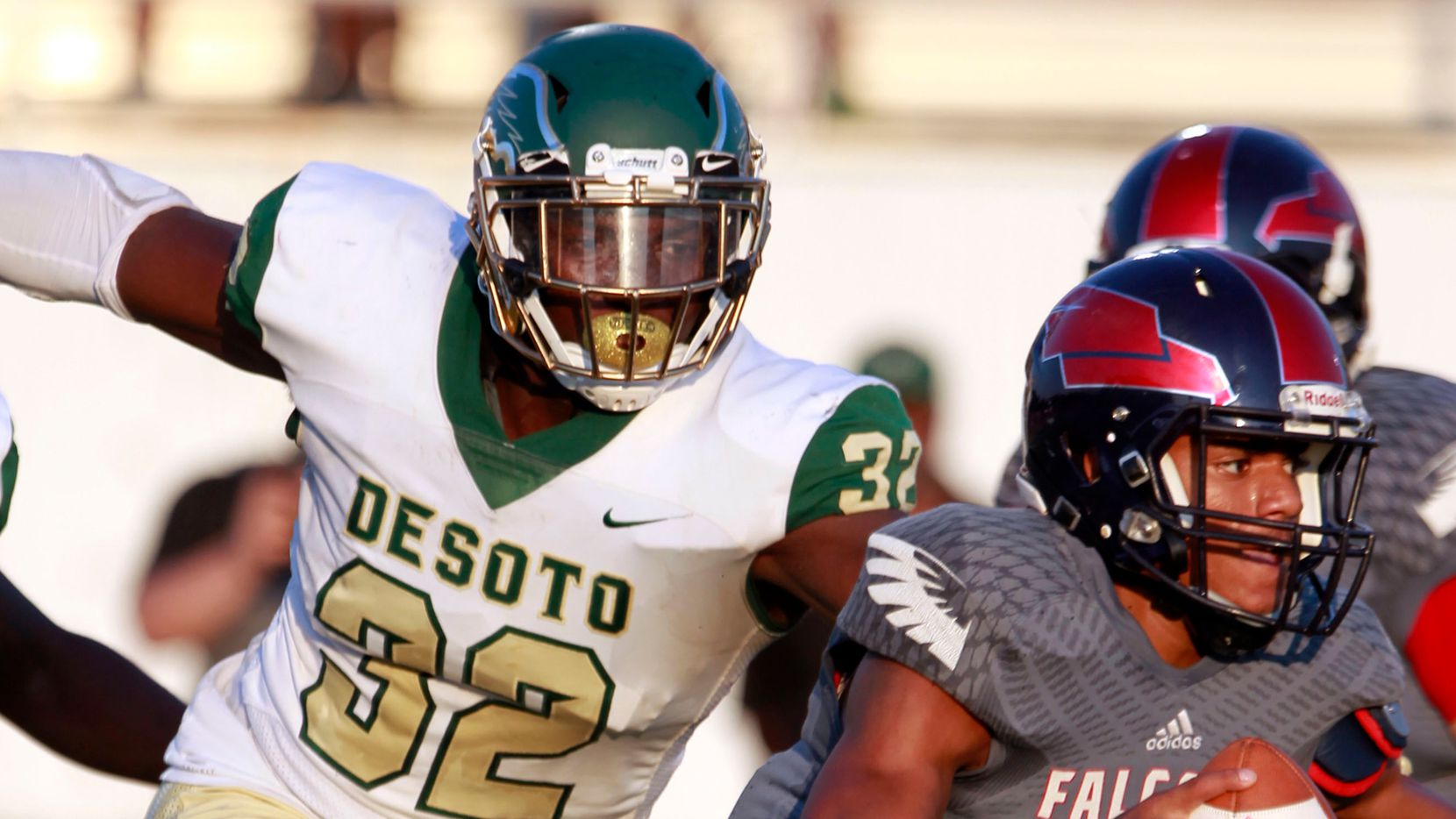 DeSoto defensive lineman Shemar Turner (32) chases down Bishop Dunne quarterback Simeon Evans (1) during a game at Sprague Stadium in Dallas on Saturday, September 14, 2019.  Turner is one of six DeSoto players ranked in The Dallas Morning News' Area Top 100 for the Class of 2021, the most of any school.