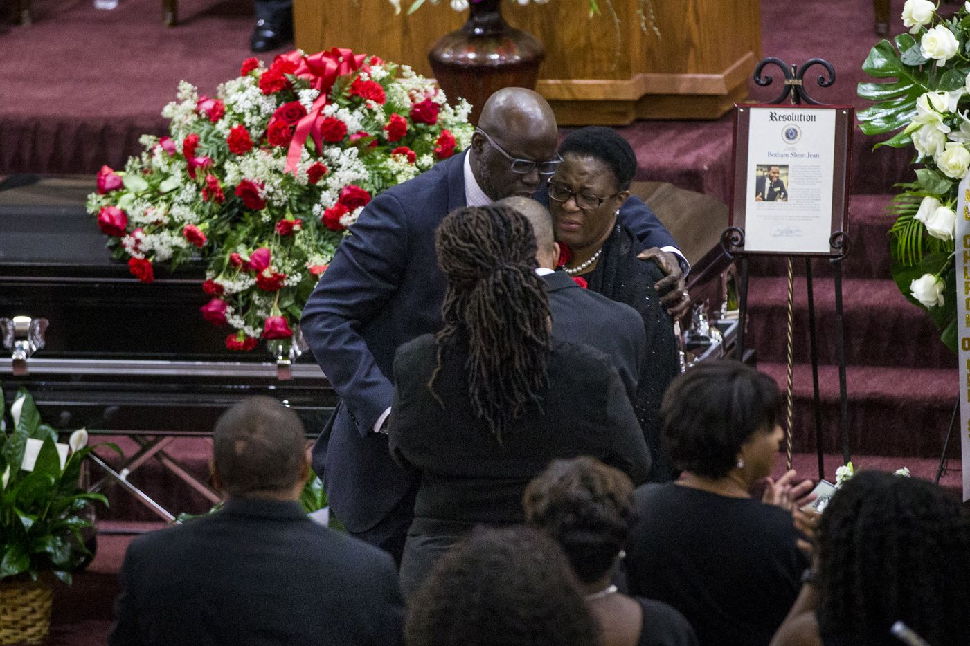 Dane Felicien embraces the Jean family after paying tribute to their son during the funeral service for Botham Shem Jean at the Greenville Avenue Church of Christ on Thursday, September 13, 2018 in Richardson, Texas. He was shot and killed by a Dallas police officer in his apartment last week in Dallas. (Shaban Athuman/ The Dallas Morning News)