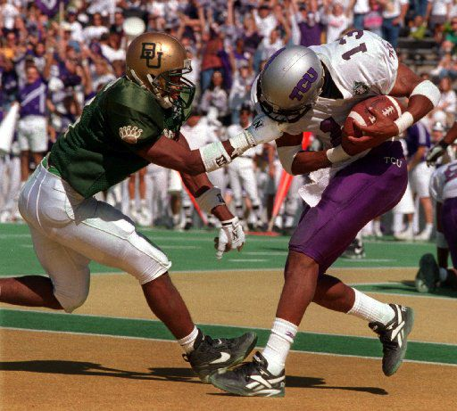 ORG XMIT:  Shot 10/28/95 - Baylor defensive back, Joe Manor,  grabs the face mask of TCU's Chris Brasfield as Brasfield makes a  2nd quarter TD Saturday afternoon in Waco.   08302006xSPORTS