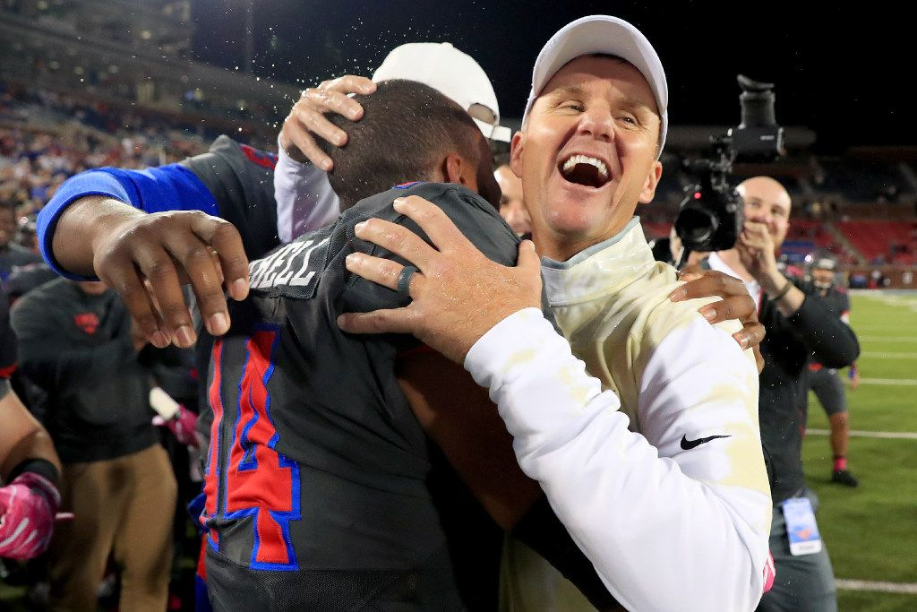 DALLAS, TX - OCTOBER 22:  Head coach Chad Morris of the Southern Methodist Mustangs celebrates with Jackson Mitchell #44 of the Southern Methodist Mustangs after the Southern Methodist Mustangs beat the Houston Cougars 38-16 at Gerald J. Ford Stadium on October 22, 2016 in Dallas, Texas.  (Photo by Tom Pennington/Getty Images) *** BESTPIX ***