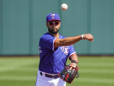 Texas Rangers shortstop Isiah Kiner-Falefa makes a throw during the first inning of a spring training game against the Cleveland Indians at Surprise Stadium on Tuesday, March 9, 2021, in Surprise, Ariz.
