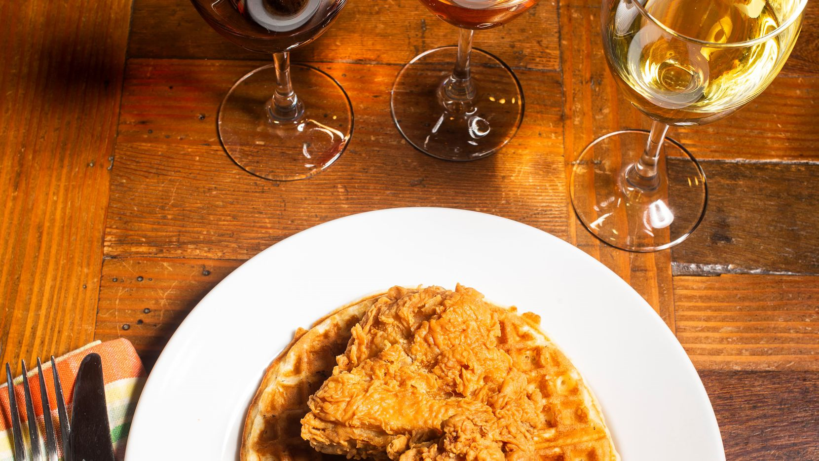 Chicken waffles and wine photographed during a wine panel in Dallas on Wednesday, May 15, 2019. (Shaban Athuman/Staff Photographer)