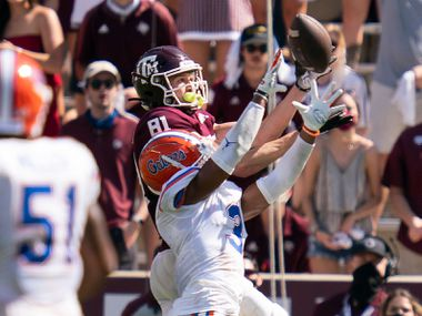 Texas A&M wide receiver Caleb Chapman (81) catches a pass for a touchdown as Florida defensive back Marco Wilson (3) defends during the second half of an NCAA college football game, Saturday, Oct. 10, 2020. in College Station, Texas. (AP Photo/Sam Craft)