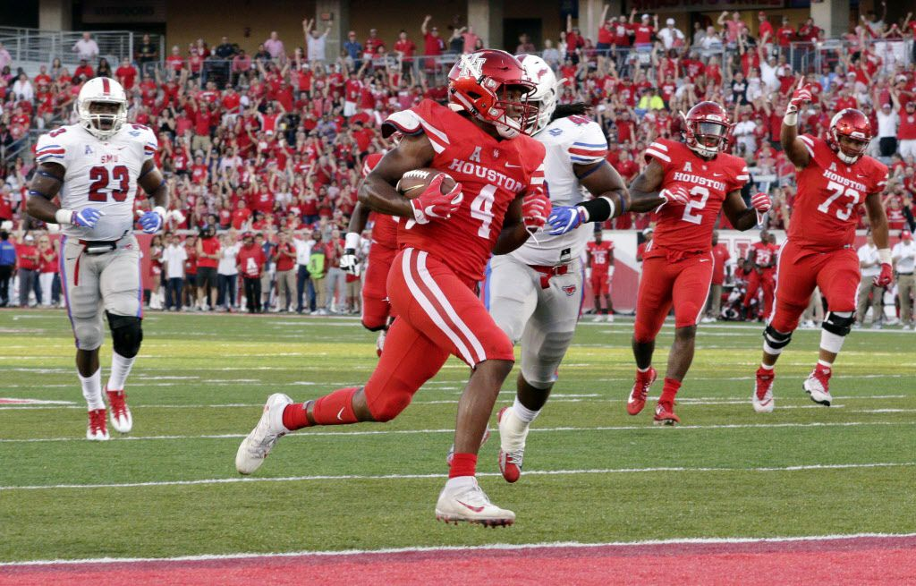 Houston wide receiver D'Eriq King (4) scores against SMU in the first half of an NCAA college football game Saturday, Oct. 7, 2017, in Houston. (AP Photo/Michael Wyke)