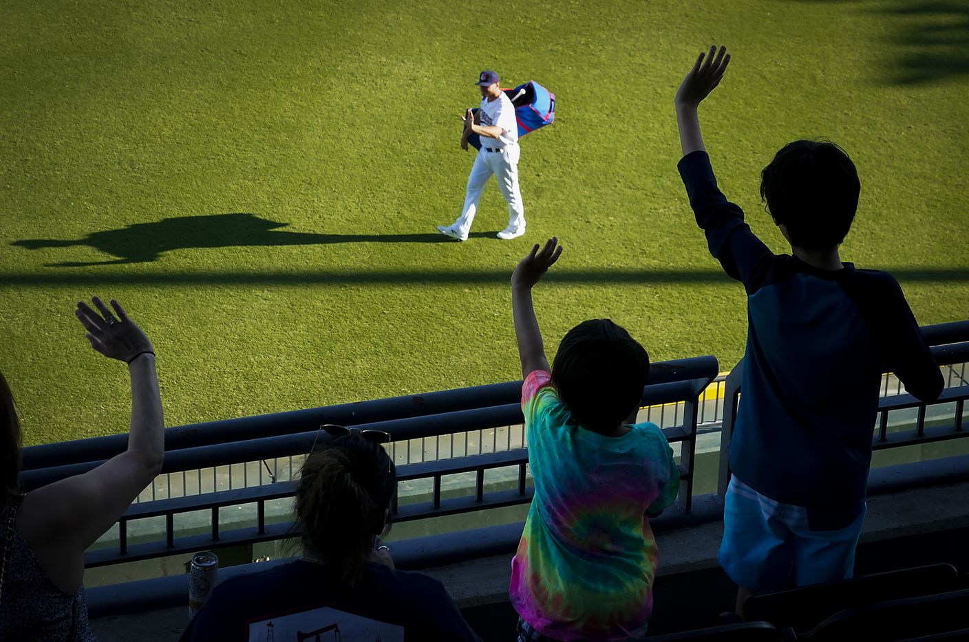 Fans wave to Round Rock Express catcher John Hicks as he takes the field to warm up at Dell Diamond for the season opener against the Oklahoma City Dodgers on Thursday, May 6, 2021, in Round Rock, Texas. It was the first gamer for the Express in 601 days due to the COVID-19 pandemic.