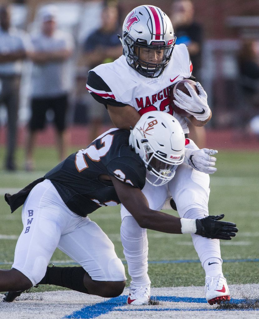 Arlington Bowie defensive back Tre Martin (22) tackles Flower Mound Marcus running back Ty'son Edwards (22) during the first quarter of a high school football game between Flower Mound Marcus and Arlington Bowie on Thursday, August 29, 2019 at Wilemon Field in Arlington. (Ashley Landis/The Dallas Morning News)