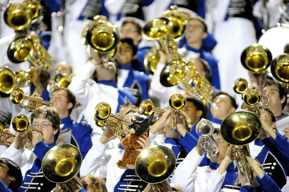 The Allen Escadrille performs in the stands during a Class 5A high school football game against Coppell on Sept. 28, 2012, at Cowboy Stadium in Coppell.