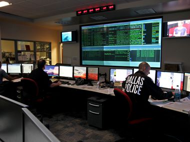 In this September 2010 file photo, from fight to left, detectives Jerod Honrath, Keith Allen and Orlando Robinson monitor tests of the then-new iWatchDallas program in the Fusion Center at Dallas Police Headquarters.