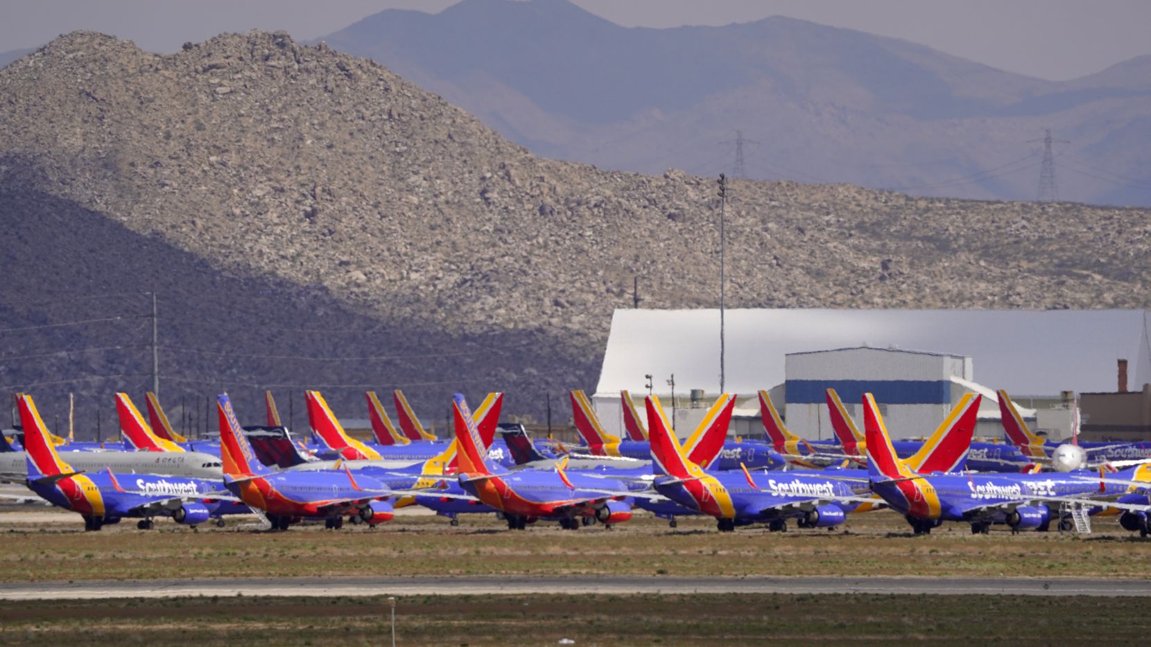 Passenger and cargo aircraft are seen stored at Southern California Logistics Airport, Wednesday, March 25, 2020, in Victorville, Calif.