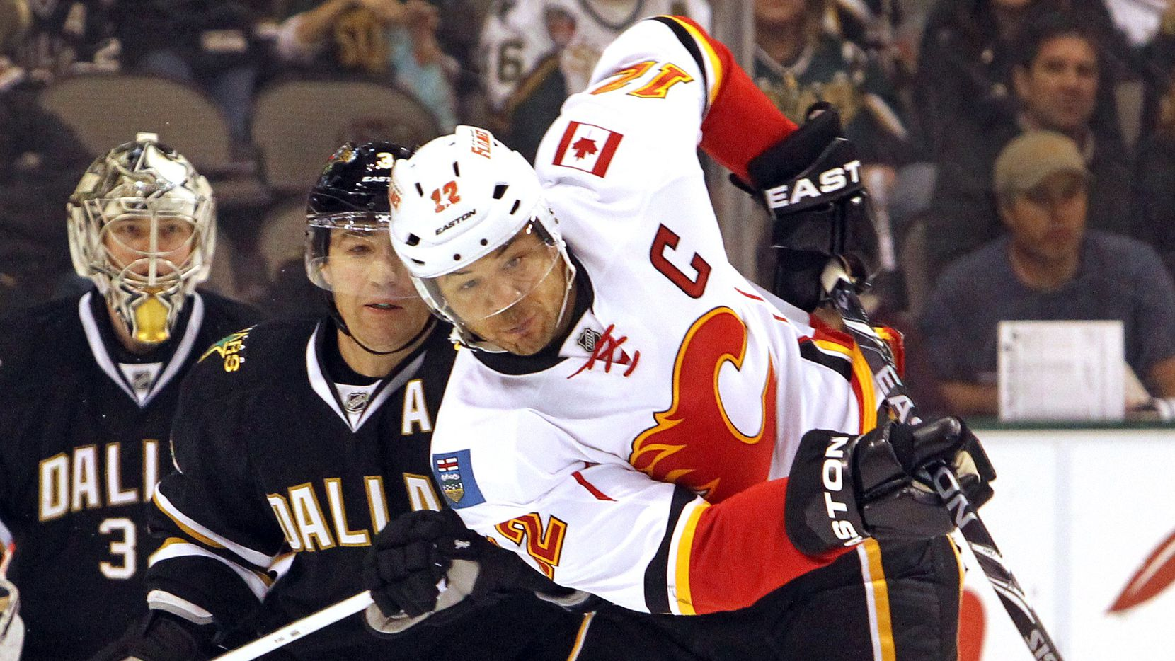 Calgary's Jarome Iginla (12) tries to redirect the puck as Dallas' Stephane Robidas (3) defends in the second period during the Dallas Stars vs. the Calgary Flames NHL hockey game at the American Airlines Center on Saturday, March 24, 2012.