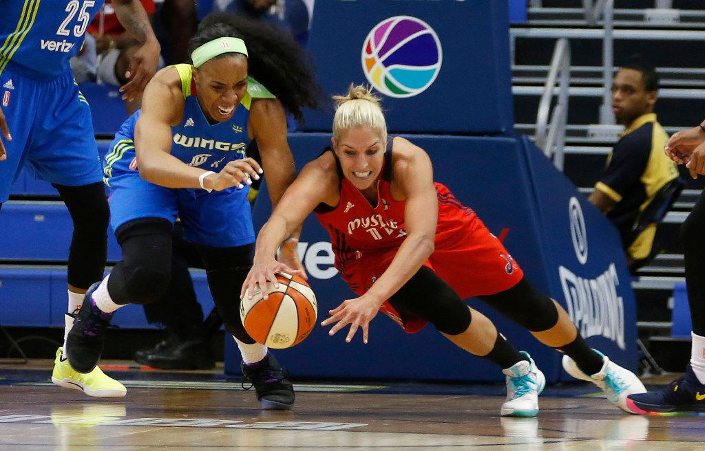 Dallas Wings forward Kayla Thornton (6) and Washington Mystics guard Elena Delle Donne (11) dive after a loos ball during the first half of play at UTA's College Park Center in Arlington on Tuesday, June 6, 2017. (Vernon Bryant/The Dallas Morning News)