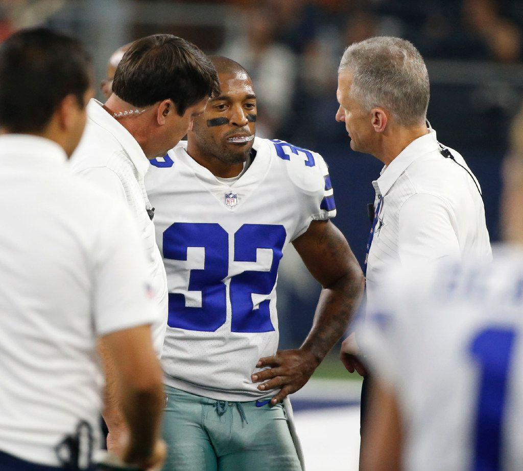 Dallas Cowboys medical staff talks with Dallas Cowboys cornerback Orlando Scandrick (32) after a play during the first half of a preseason game against the Indianapolis Colts at AT&T Stadium in Arlington on Saturday, August 19, 2017. (Vernon Bryant/The Dallas Morning News)