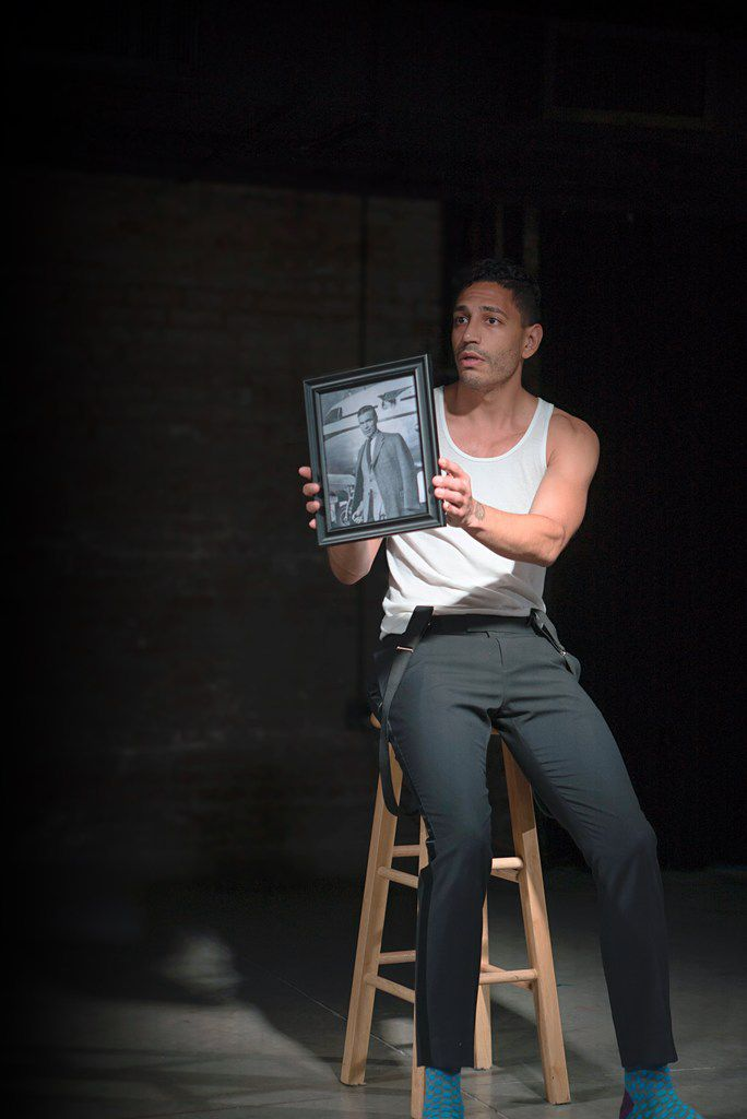 Christopher Rivas holds a photo of the late diplomat and playboy Porfirio Rubirosa during his show.