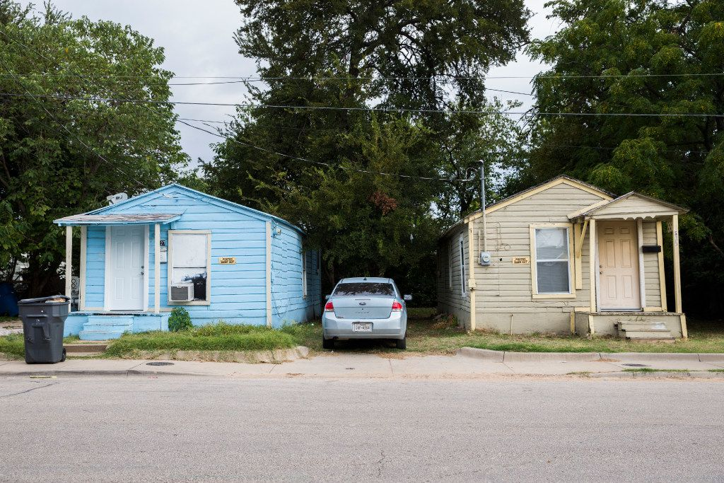 HMK rental homes on Nomas Street in West Dallas.  The rental company says it wants to get out of the business, but mass evictions at its properties would leave hundreds scrambling for shelter. (Ashley Landis/The Dallas Morning News)