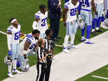 Dallas Cowboys defensive tackle Dontari Poe (95) kneels for the national anthem alongside linebacker Justin March (59) and safety Donovan Wilson (37) before an NFL football game against the Atlanta Falcons at AT&T Stadium on Sunday, Sept. 20, 2020, in Arlington.
