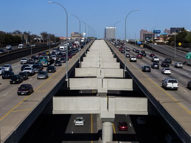 Vehicles make their way through Interstate 635 (outer lanes) and the Interstate 635 Express toll road (center) near the Rosser Road overpass in Dallas.