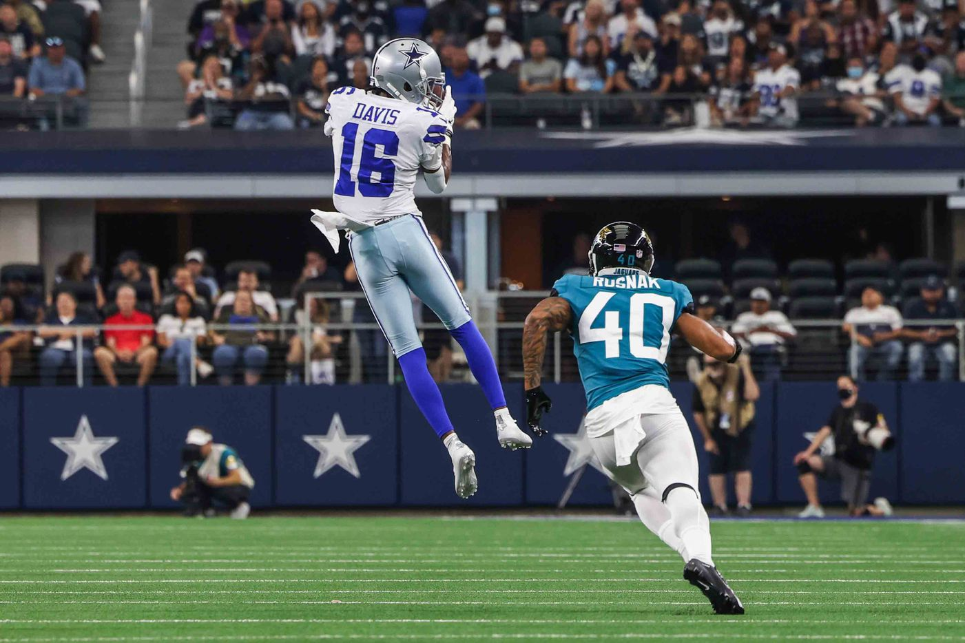Dallas Cowboys' WR Reggie Davis, 16, catches the football in the air as Jacksonville Jaguars' FS Brandon Rusnak, 40, tries to catch him during the 2nd quarter of a preseason game at AT&T stadium in Arlington on Sunday, August 29, 2021. (Lola Gomez/The Dallas Morning News)