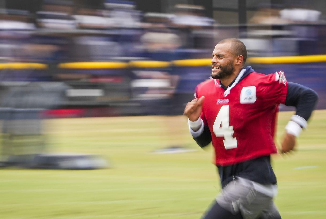 Dallas Cowboys quarterback Dak Prescott (4) runs on the field following a practice at training camp on Sunday, July 25, 2021, in Oxnard, Calif.