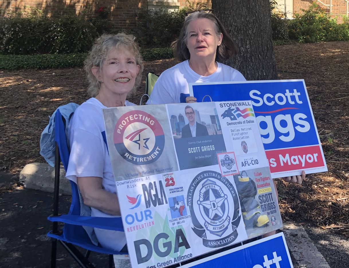 Jane Hoffman, left, and Erica Cole sit outside of the Our Redeemer Lutheran Church on Thursday, May 30, 2019, holding their signs of support for Dallas mayoral candidate Scott Griggs. Griggs' rival, Texas state Rep. Eric Johnson, went on social media on Wednesday to accuse Griggs' supporters of stealing campaign signs and intimidating voters at the church.