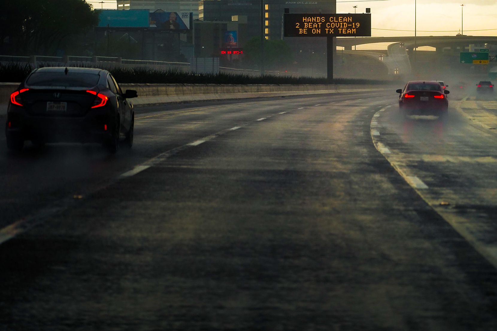 A traffic sign gave advice on hand-washing to combat COVID-19 as traffic headed north on U.S. 75 near Churchill Way in the rain on March 19, 2020, in Dallas. Contributing to the mounting gloom of the coronavirus pandemic, according to NBC5, it rained 11 straight days from March 12-22, setting an all-time record for days with consecutive rainfall.