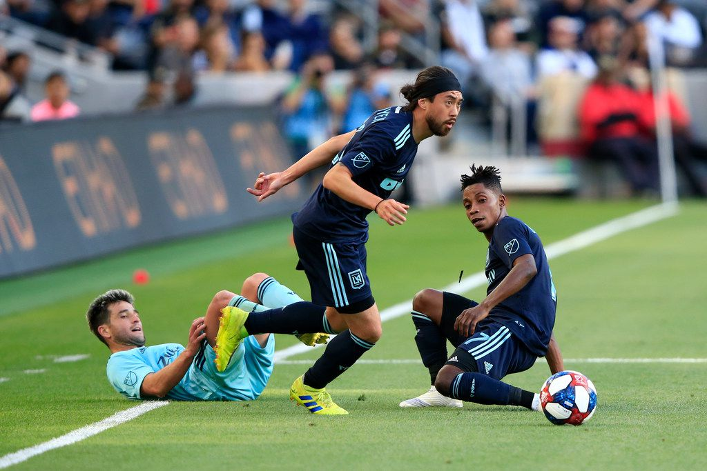 LOS ANGELES, CALIFORNIA - APRIL 21:  Lee Nguyen #24 and Latif Blessing #7 of Los Angeles FC steal the ball from Nicolas Lodeiro #10 of Seattle Sounders during the second half of a game at Banc of California Stadium on April 21, 2019 in Los Angeles, California. (Photo by Sean M. Haffey/Getty Images)